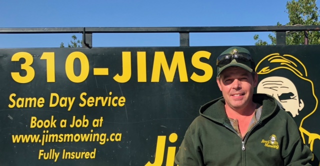 Wayne Ross our Jim's Mowing franchisee in Burnaby and New Westminster in front of trailer