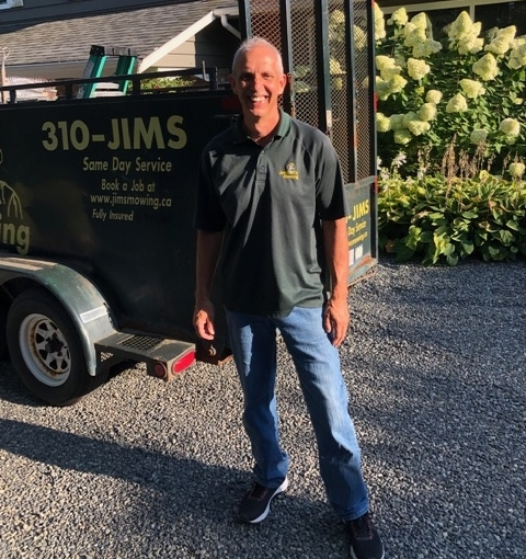 Dan Martin our Jim's Mowing franchisee in White Rock in front of trailer