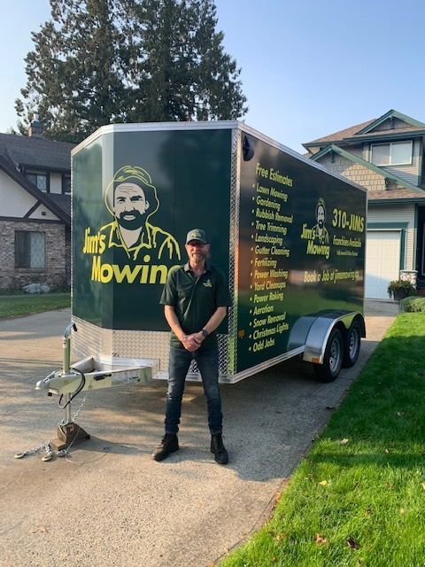 George Missel our Jim's Mowing franchisee in Langley in front of his trailer