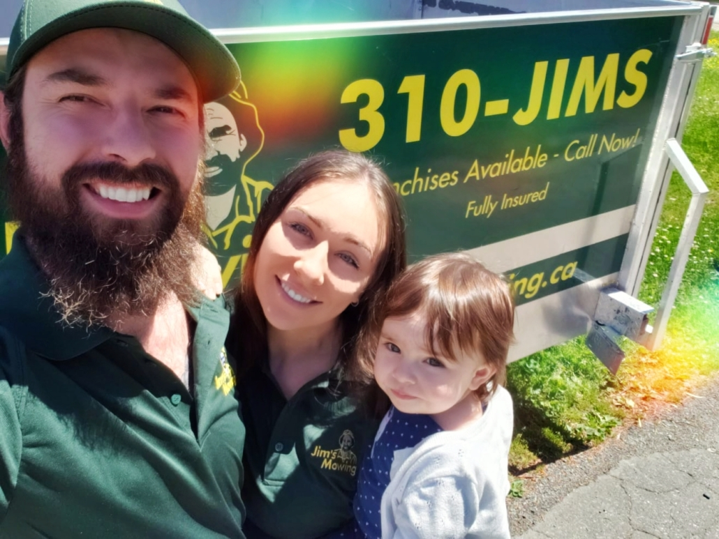 Brandon Stasiuk our Jim's Mowing franchisee in North Delta and Surrey in front of trailer