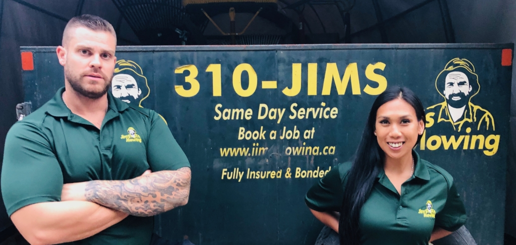 Annabelle Ilano And Will Nezezon our Jim's Mowing franchisee in Maple Ridge in front of his trailer