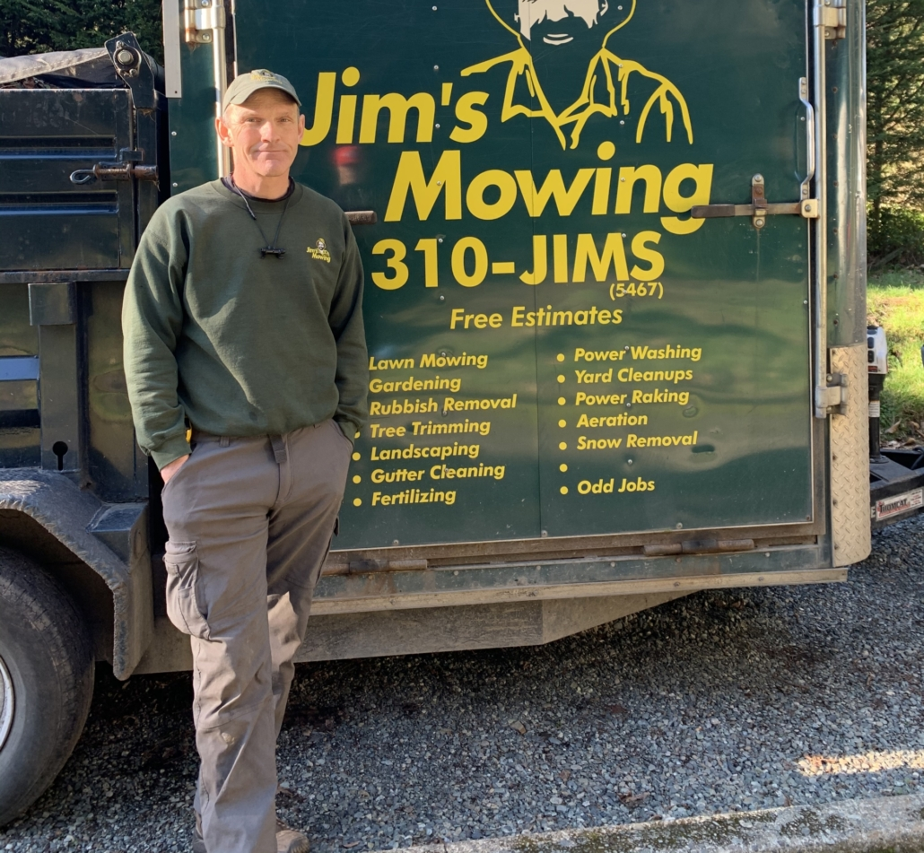 Joel Pendergast our Jim's Mowing franchisee in Victoria in front of trailer