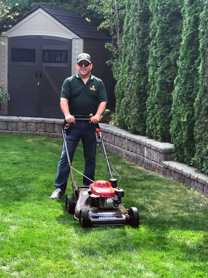 Ken Douglas our Jim's Mowing franchisee in South Surrey in front of his mower
