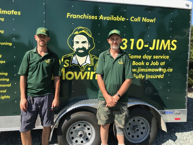 Lee and Shane Nutt our Jim's Mowing franchisee in White Rock in front of trailer