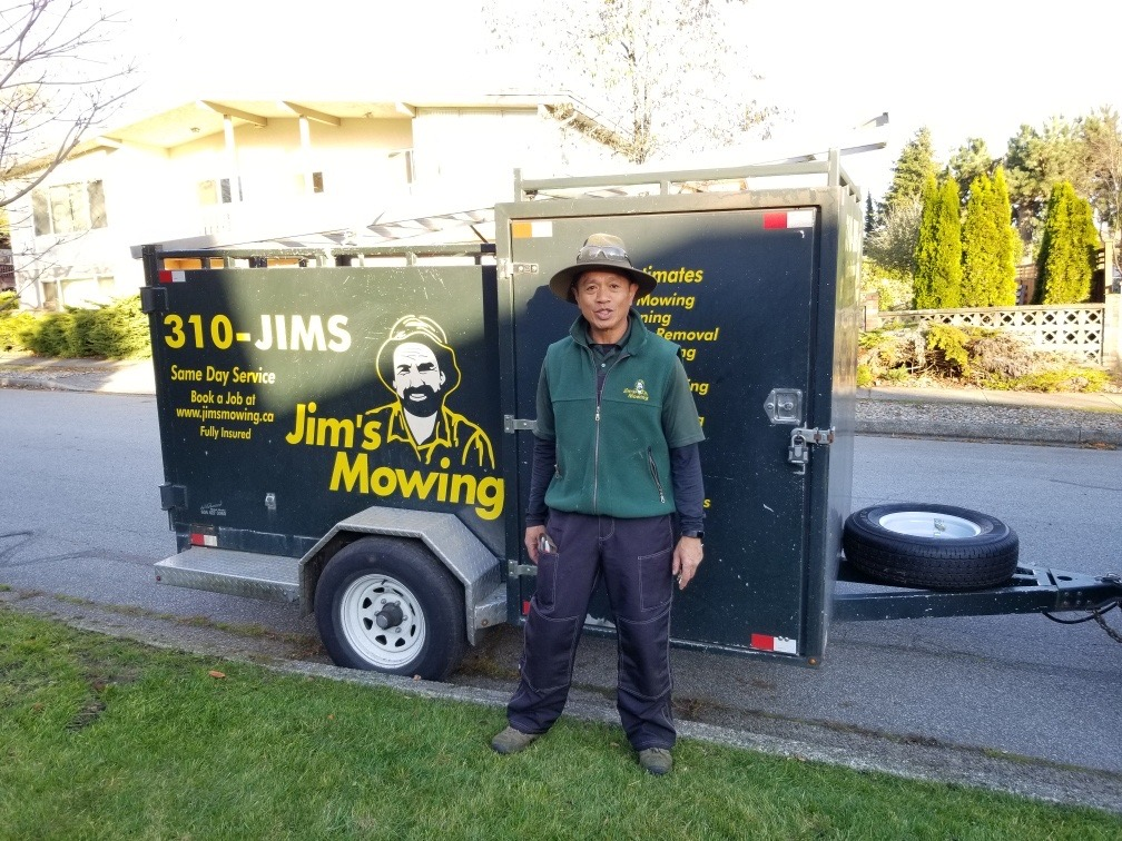 Mario Cachero our Jim's Mowing franchisee in Vancouver in front of trailer