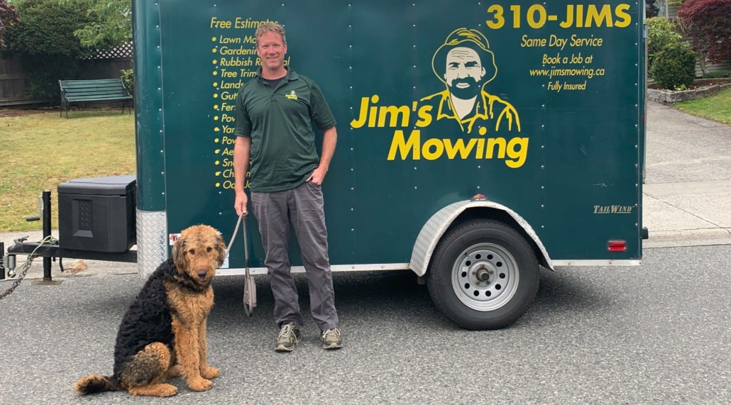Michael Linder our Jim's Mowing franchisee in Nanaimo in front of trailer