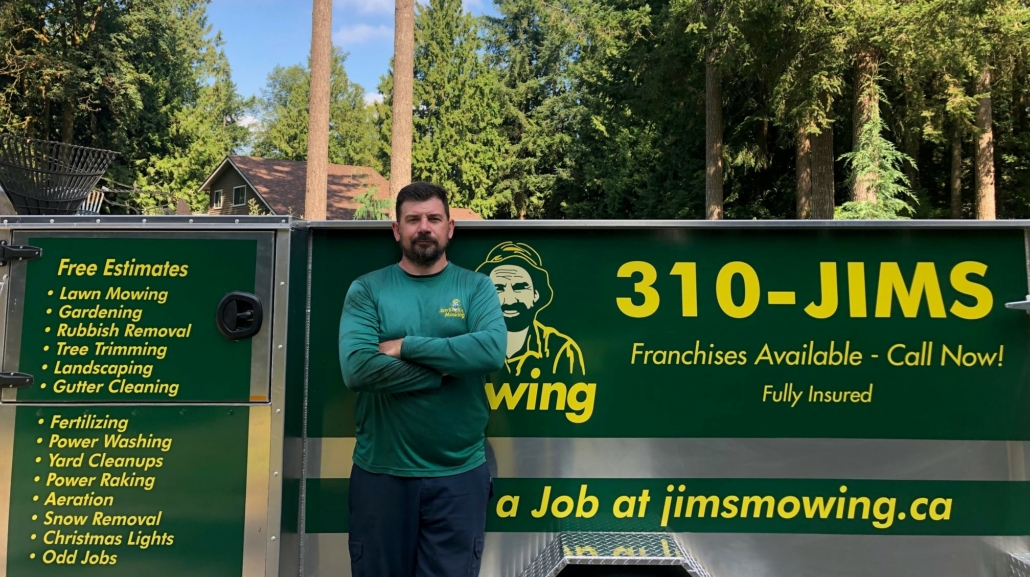 Mike McInnes our Jim's Mowing franchisee in Langley in front of trailer