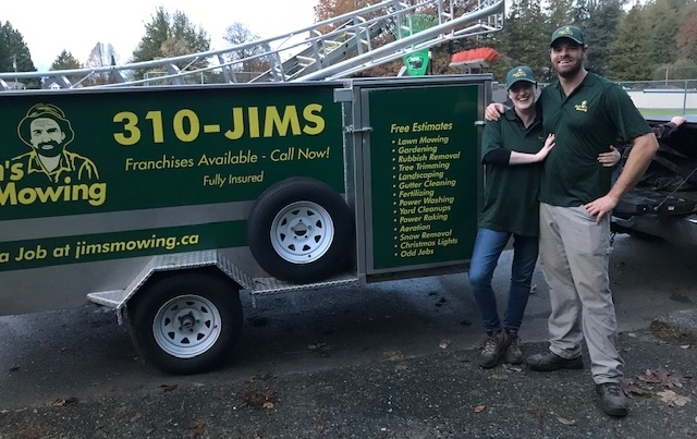 Rio & Breanne Kemle our Jim's Mowing franchisee in Abbotsford in front of trailer