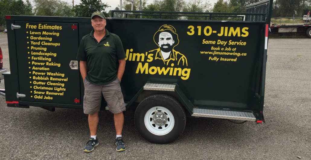 Ron Samson our Jim's Mowing franchisee in Port Moody in front of trailer