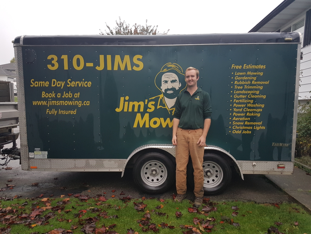Samual Ravensbergen our Jim's Mowing franchisee in Langley in front of trailer