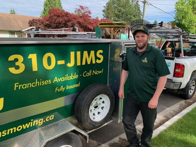 Steve Campbell our Jim's Mowing franchisee in Nanaimo, South Parksville and Nanoose in front of trailer