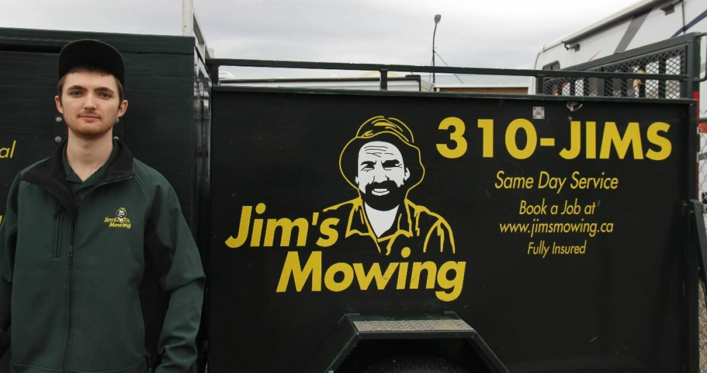 Steven Hoy our Jim's Mowing franchisee in Penticton in front of trailer