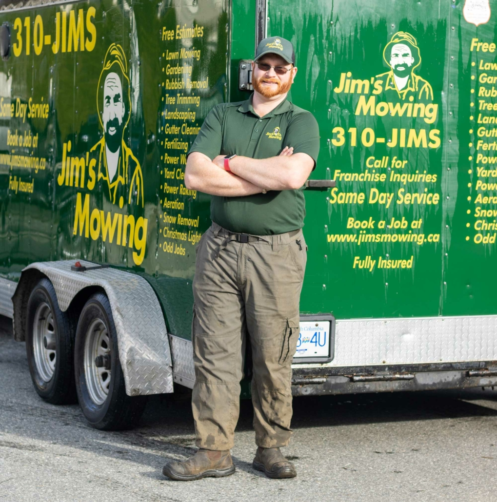 Wille Brimacombe our Jim's Mowing franchisee in Mission and Abbotsford in front of trailer