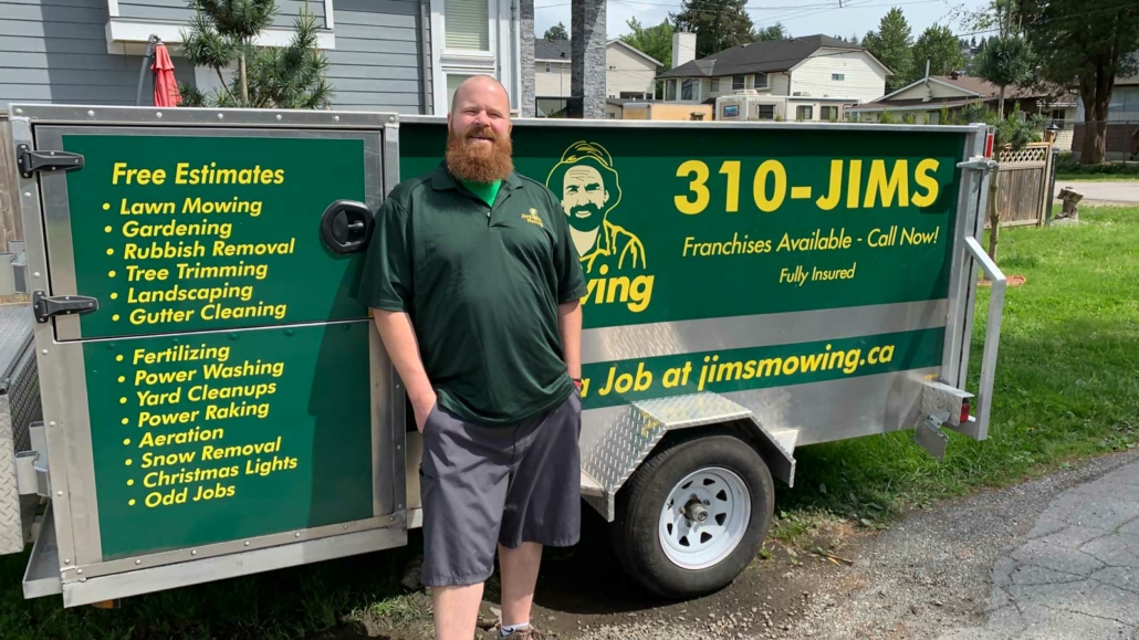 Chris Thomsen our Jim's Mowing franchisee in Abbotsford in front of trailer
