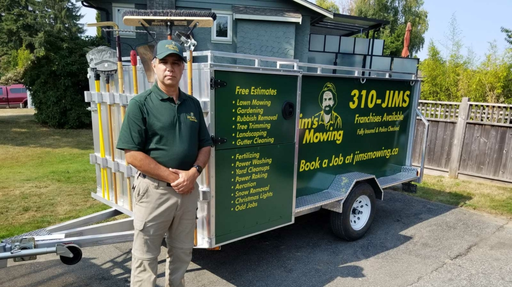 Antonio Hurtado-Coll our Jim's Mowing franchisee in North Delta and Surrey in front of trailer
