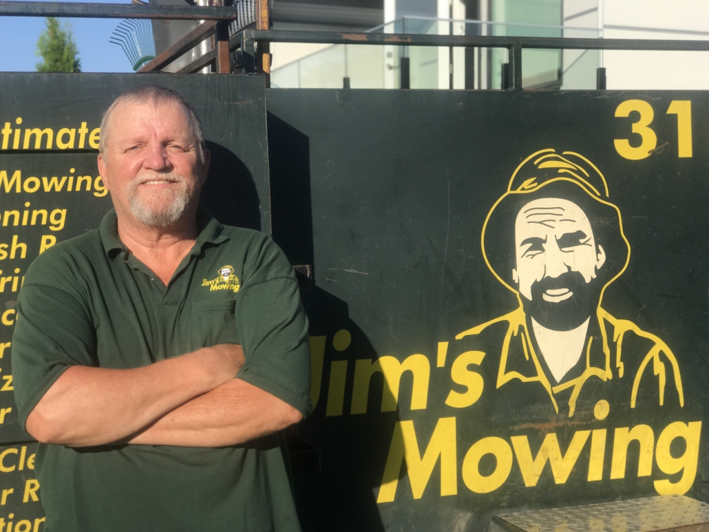Stu Colcleugh our Jim's Mowing franchisee in North and West Vancouver in front of trailer