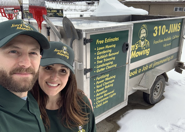 Jeff Jeff Skuggedal our Jim's Mowing franchisee in Kelowna in front of trailer