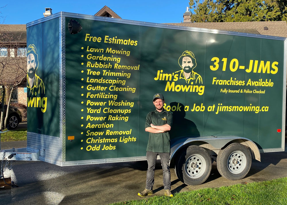 Jeff Ross our Jim's Mowing franchisee in Campbell River in front of trailer 2